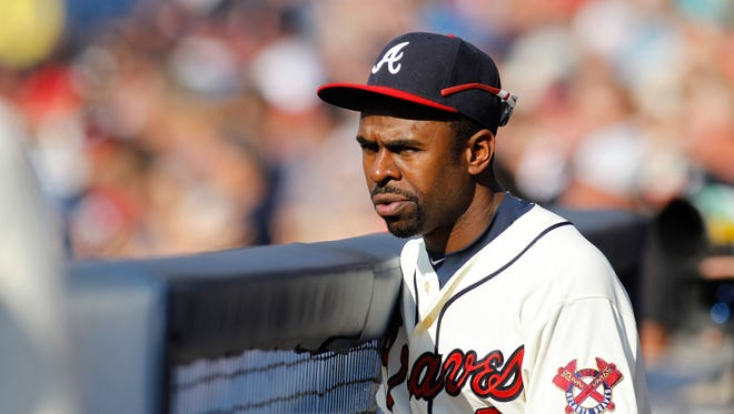 Aug 9, 2015: Atlanta Braves center fielder Michael Bourn (2) watches a game against the Miami Marlins in the fourth inning at Turner Field.