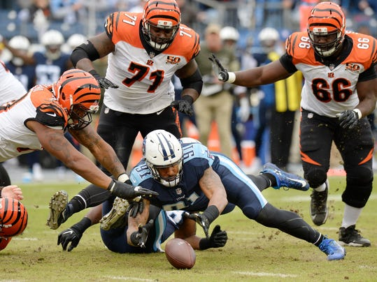 Tennessee Titans outside linebacker Derrick Morgan (91) recovers a fumble after Cincinnati Bengals quarterback Andy Dalton, not shown, was sacked in the first half of an NFL football game Sunday, Nov. 12, 2017, in Nashville, Tenn. (AP Photo/Mark Zaleski)