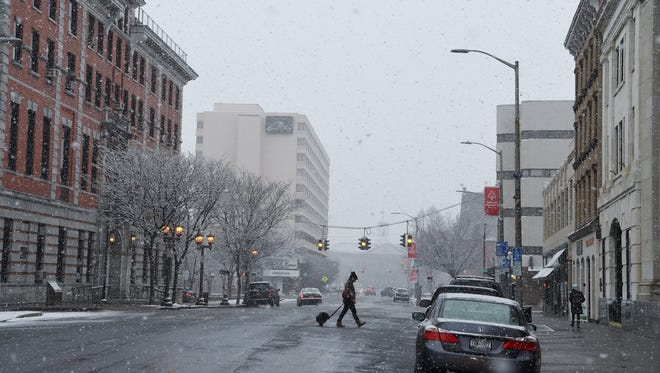 Snow falls while looking North up Market Street in the City of Poughkeepsie on Tuesday.