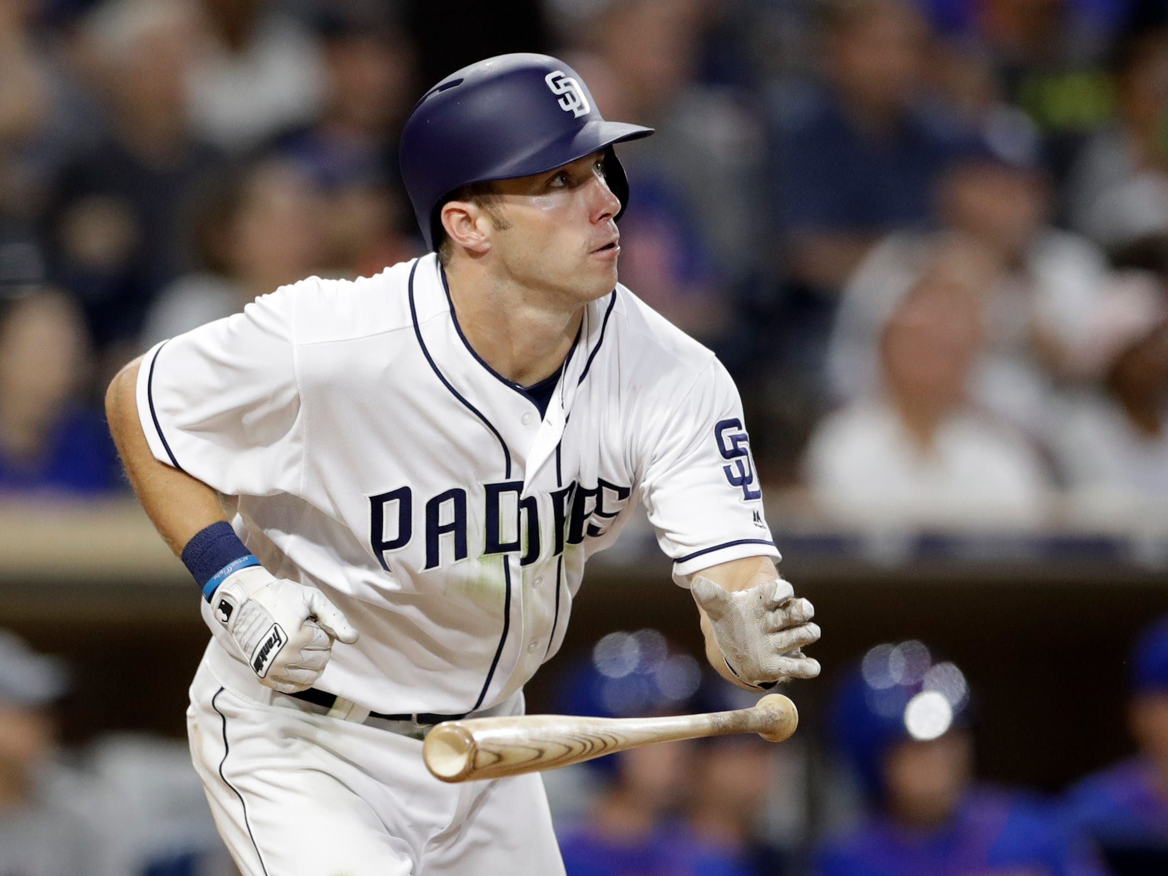 San Diego Padres' Dusty Coleman watches his three-run
