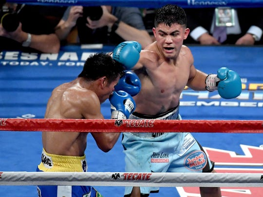 Joseph Diaz Jr. throws a punch at Rafael Rivera during their featherweight bout at T-Mobile Arena on September 16, 2017 in Las Vegas, Nevada.  (Photo by Ethan Miller/Getty Images)