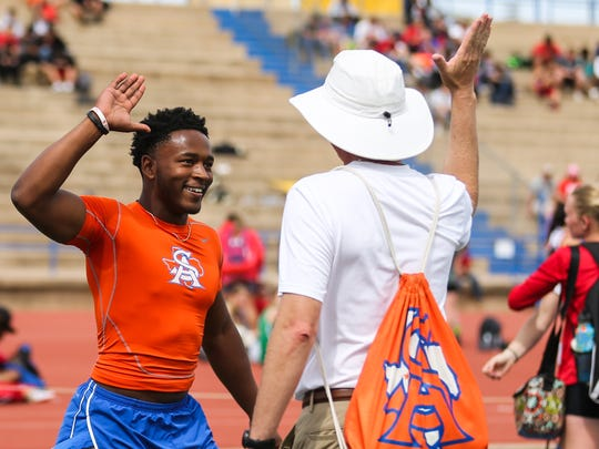 San Angelo Central's Demarcus Cobb celebrates after competing in the 100 meter dash during the San Angelo Relays on Friday, March 23, 2018, at San Angelo Stadium.