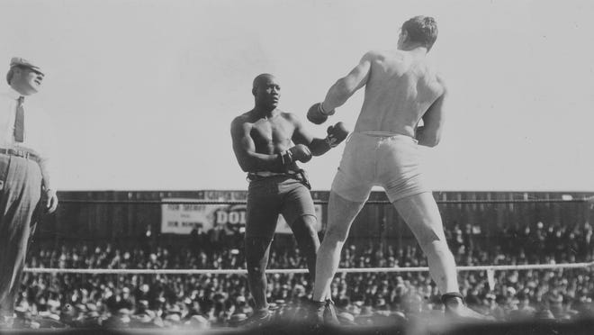 World heavyweight champion Jack Johnson battled with challenger Al Kaufmann in a 1909 title bout.