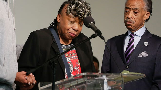 Gwen Carr, Eric Garner's mother, and the Rev. Al Sharpton attend a rally Saturday in New York to celebrate the city medical examiner's homicide ruling.