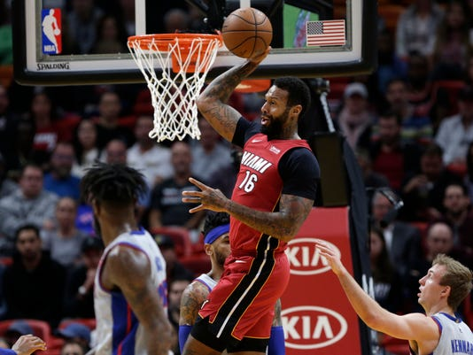 Miami Heat's James Johnson (16) passes over Detroit Pistons' Luke Kennard, right, during the first half of an NBA basketball game, Wednesday, Jan. 3, 2018, in Miami. (AP Photo/Lynne Sladky)
