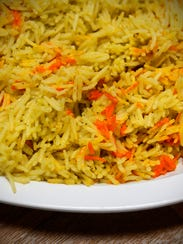 A large side of seasoned basmati rice is popular at