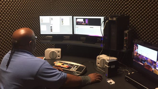 C.M. Brown works at a TBNK editing bay. He's editing Suits that Rock, charitable concerts that bring together musically talented executives.