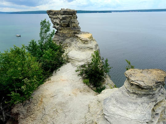 Michigan's Upper Peninsula has a wide variety of rocks and minerals for rock sleuths. These sandstone rock formations known as Miner's Castle at the Pictured Rocks are on Lake Superior .