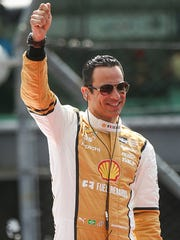 IndyCar driver Helio Castroneves  is introduced before the start of the 101st running of the Indianapolis 500 at Indianapolis Motor Speedway, Sunday, May 28, 2017.
