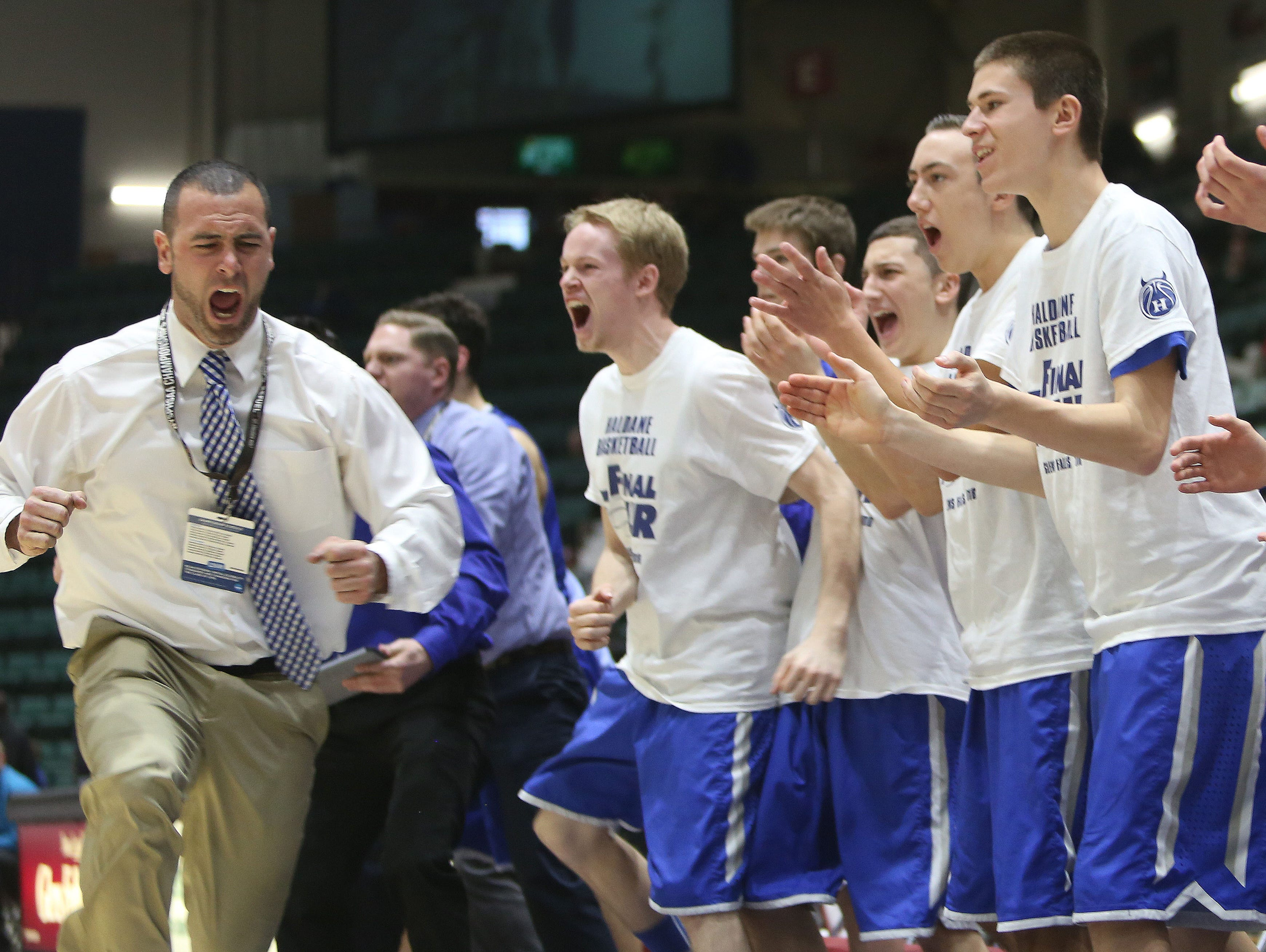 From left, Haldane coach Joe Virgadamo and his team react to a big basket late in the game against Moravia during the boys Class C semifinal at the Glens Falls Civic Center March 11, 2016. Haldane won the game 36-34.