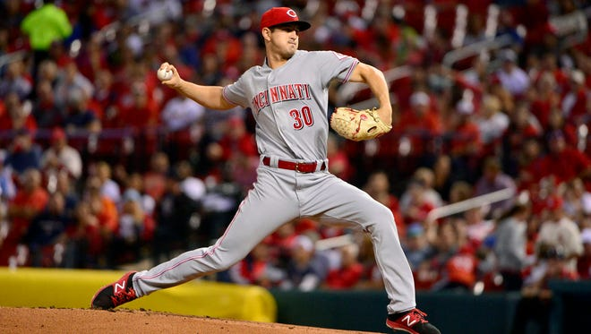 Cincinnati Reds starting pitcher Tyler Mahle (30) pitches during the first inning against the St. Louis Cardinals at Busch Stadium.