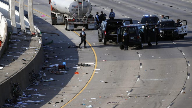 Police clear the area where a tanker truck rushed to a stop among protesters on an interstate Sunday, May 31, 2020, in Minneapolis. Protests continued following the death of George Floyd, who died after being restrained by Minneapolis police officers on Memorial Day.