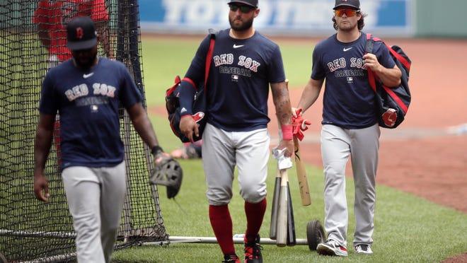 Red Sox baseball left fielder Andrew Benintendi, right, follows center fielder Kevin Pillar, center, to the batting cage during Summer Camp at Fenway Park.