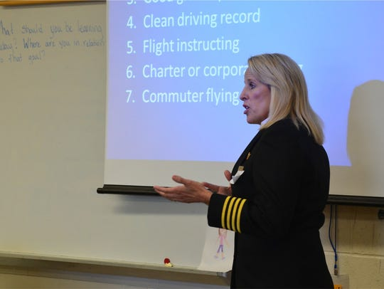 Delta captain Lisa Mrozek of Saline speaking to a classroom.