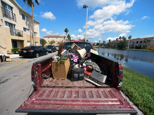 A truck bed is filled with belongings Thursday, Sept. 14, 2017, as first-floor residents evacuate their homes because of flooding caused by Hurricane Irma at Sabal Chase Apartments in Fort Pierce.