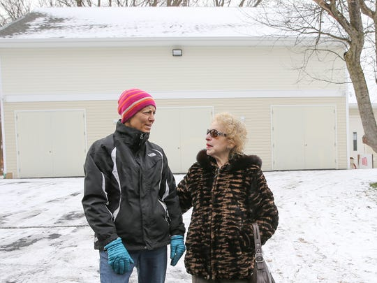 Chestnut Ridge residents, Hilda Kogut, left, and Carole Goodman are photographed outside the three-car garage being used illegally as a synagogue. Friday, December 15, 2017.