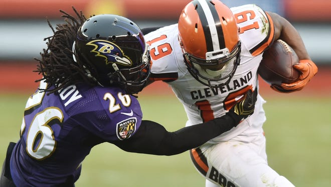 Dec 17, 2017; Cleveland, OH, USA; Baltimore Ravens cornerback Maurice Canady (26) tackles Cleveland Browns wide receiver Corey Coleman (19) during the second half at FirstEnergy Stadium. Mandatory Credit: Ken Blaze-USA TODAY Sports