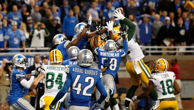 Green Bay's Richard Rodgers grabs a touchdown on a Hail Mary pass on a free play after a penalty on the game's final play during NFL Thursday Night Football against the Green Bay Packers on Dec. 3, 2015 at Ford Field in Detroit. The Packers defeated the Lions, 27-23.
