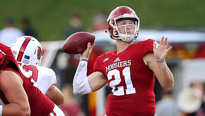 Hoosiers quarterback Richard Lagow (21) makes a pass during action against the Ball State Cardinals at Indiana University's Memorial Stadium, Bloomington, Ind., Saturday, Sept. 10, 2016.