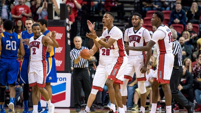 UNLV Rebels players react during a stoppage in play while playing against the San Jose State Spartans during the second half at Thomas & Mack Center. UNLV won 64-61.