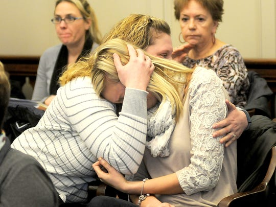 Kelly Dickerson is consoled after she spoke on behalf of her grandfather Paul Nauman and his family during the early release hearing of Cory Jackson on Friday in Morrow County.