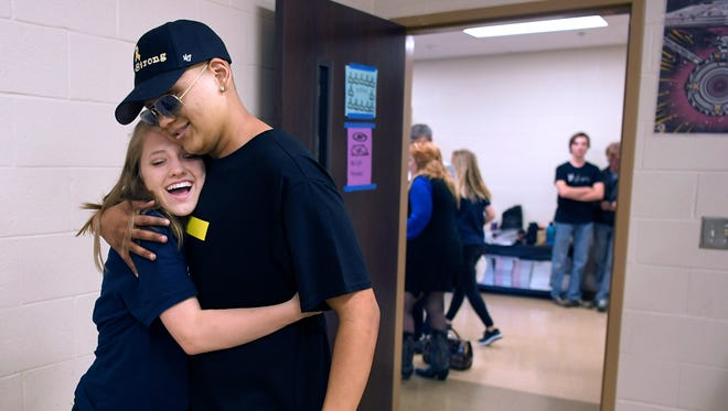 Centennial High School student Raymond Cruz hugs a friend in the green room at his school before a benefit concert in his honor on Saturday, May 6, 2017.