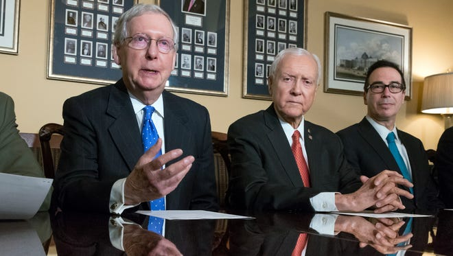 Senate Majority Leader Mitch McConnell, R-Ky., Senate Finance Committee Chairman Orrin Hatch, R-Utah, and Treasury Secretary Steven Mnuchin, speak to reporters about the Senate's version of the GOP tax reform bill.