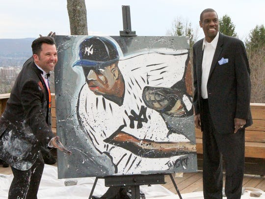 Dwight Gooden poses alongside artist John Jansky of Danville, Ill., with a painting done by Jansky of Gooden in a Yankees uniform. It was auctioned off for $600 at the Pioneers Hot Stove Dinner at the Hill Top Inn in Elmira.