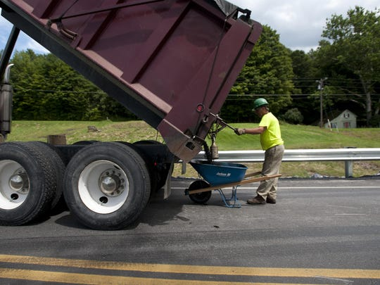 Paving crews work on Vermont 116 in Hinesburg in this file photo.
