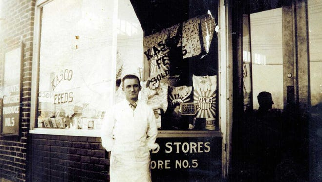 Paul Rimel, outside of Reid's Store, c. 1940.