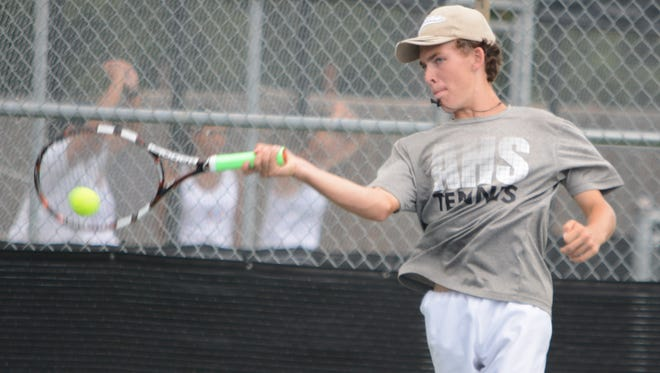 Abilene High's Clark Sullivan hits a forehand in a singles match against Lubbock Monterey's Wil Javier on the final day of the AISD Invitational Team Tournament. Sullivan has had a great district season winning his last individual match against Haltom in straight set.