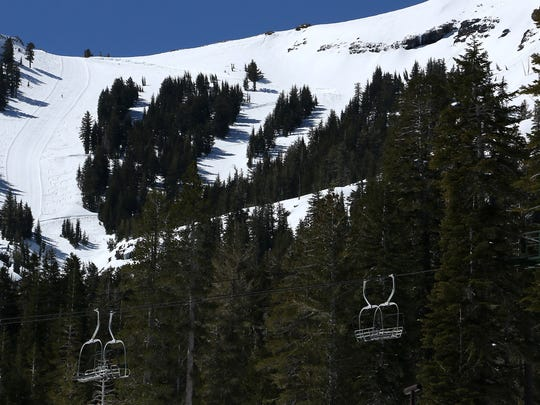 A lone skier makes his way up a run while going for a ski tour at Kirkwood after the lifts closed for the season on April 20, 2018.