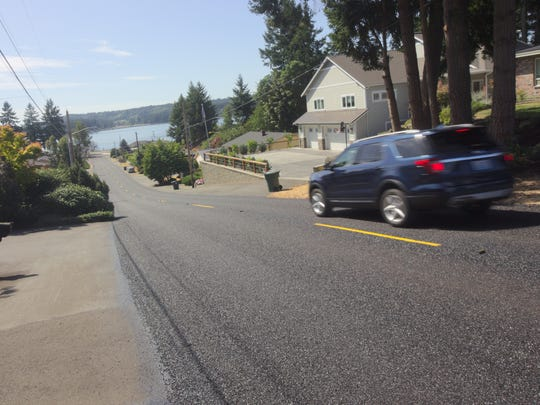 Poulsbo's 9th Avenue is one of the streets that received a new seal coat as part of the city's paving demonstration project.