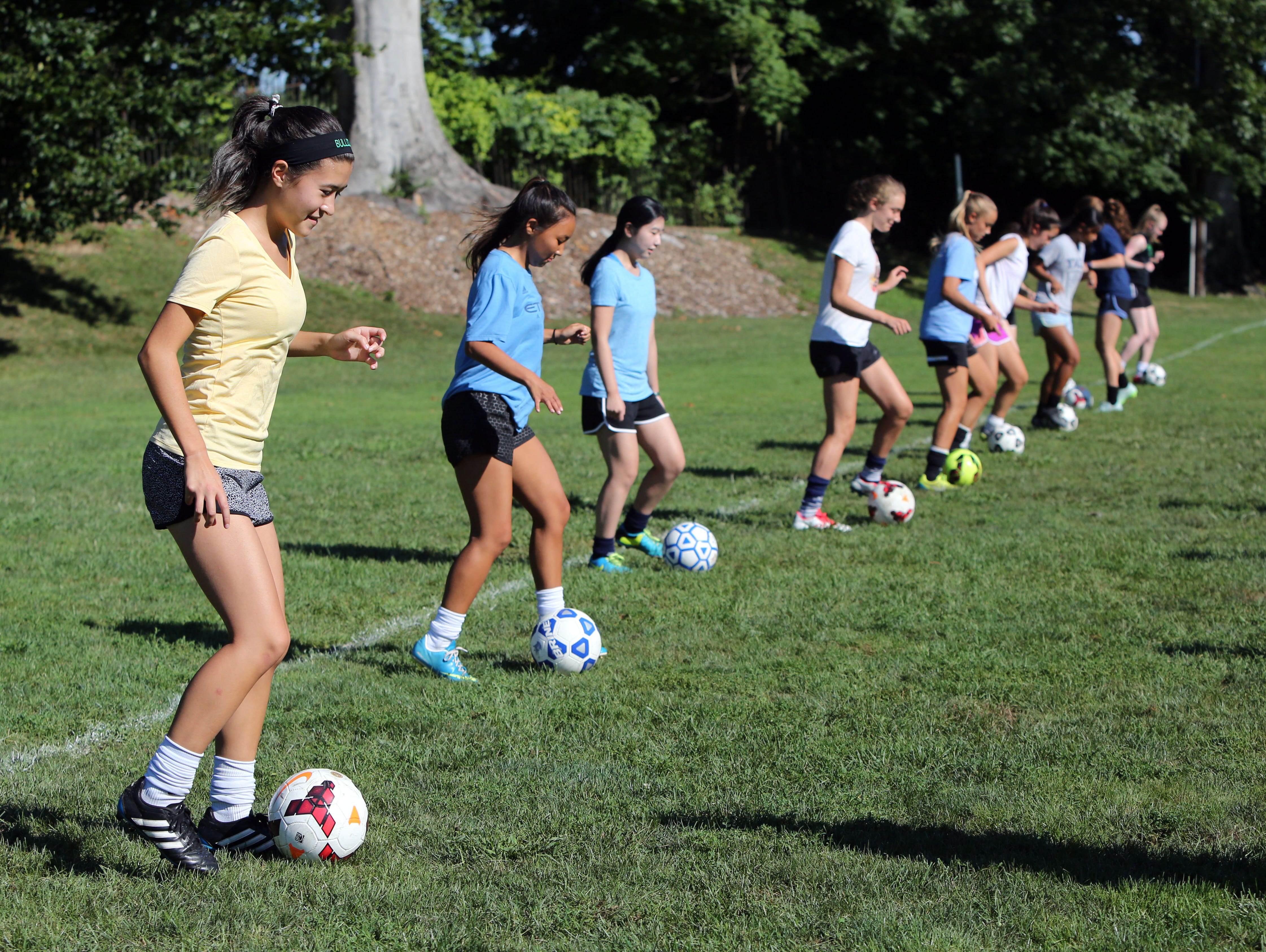 Irvington soccer co-captain Maxine Bell, left, runs through drills with the team during practice Aug. 24, 2016 at Memorial Field in Irvington.