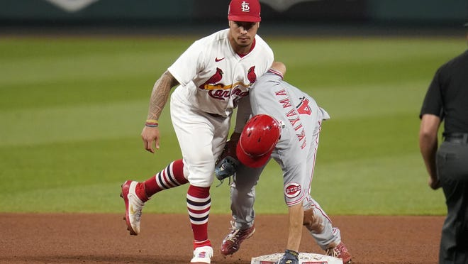 Cincinnati Reds' Shogo Akiyama (4) is tagged out by St. Louis Cardinals second baseman Kolten Wong while trying to steal second during the fifth inning of a game Friday, Sept. 11, in St. Louis.