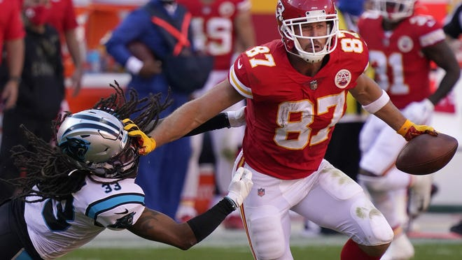 Kansas City Chiefs tight end Travis Kelce, right, runs against Carolina Panthers free safety Tre Boston (33) during the second half Sunday in Kansas City, Mo.