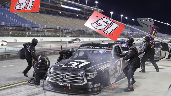 Kyle Busch (51) makes a pit stop during a NASCAR Truck Series race Saturday night in Homestead, Fla.