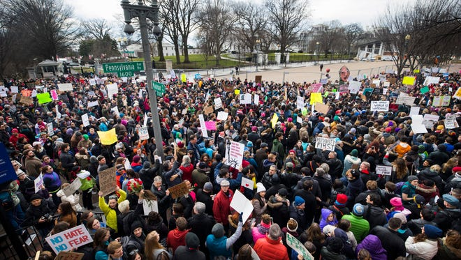 Thousands of people protest President Trump's immigration ban on citizens from seven majority-Muslim countries outside the White House in Washington, D.C., on Jan. 29, 2017.
