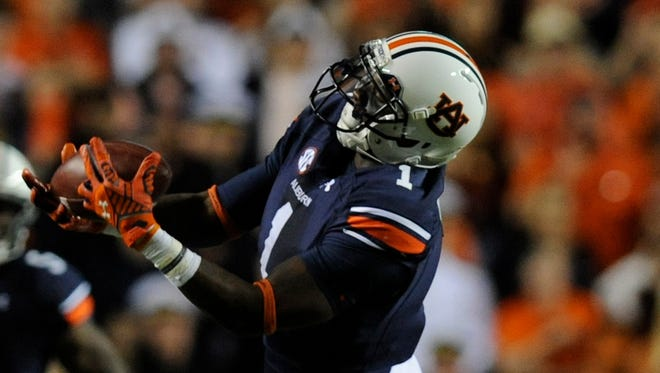 Auburn wide receiver D'haquille Williams hauls in a long reception against LSU safety Rickey Jefferson at Jordan-Hare Stadium in Auburn, Ala. on Saturday October 4, 2014.