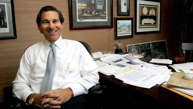 Mon Jul 06, 09. Photo by Brad Luttrell.Mark Halperin (CQ) poses in his office on 5900 Poplaer Avenue. Halperin deals in commercial real estate, and he 's executive vice president of Boyle Investments.