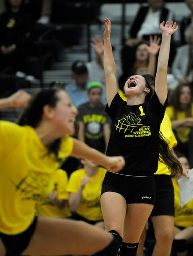 Providence's Anna Wingate (right) and teammate Patricia Mattingly celebrate a game two win against Floyd Central on Wednesday at Providence  High School. Providence won the match 3 - 0. (By David Lee Hartlage, Special to the C-J) Sept. 17, 2014.