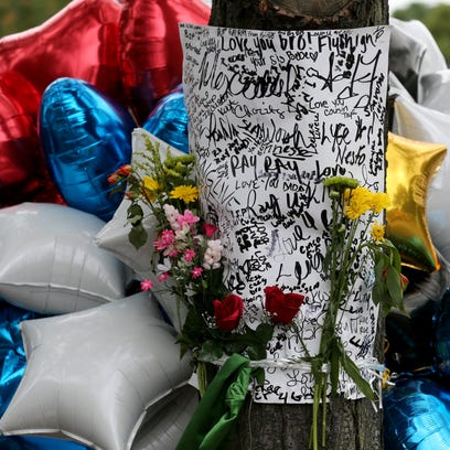 Flowers, cards, and balloons have been left after seven