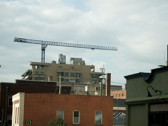 Hotel building has made cranes such as this a common occurrence in downtown Asheville (file photo).