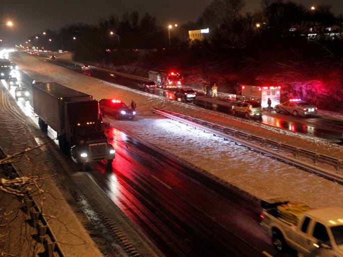 Louisville Metro Police work to clear a wreck on Interstate 264 West at US 42 in Louisville, Kentucky.       February 3 , 2014