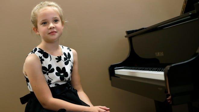 Zoe Kraus performs Wednesday, June 24, 2015, at Heid Music in downtown in Appleton, Wisconsin.