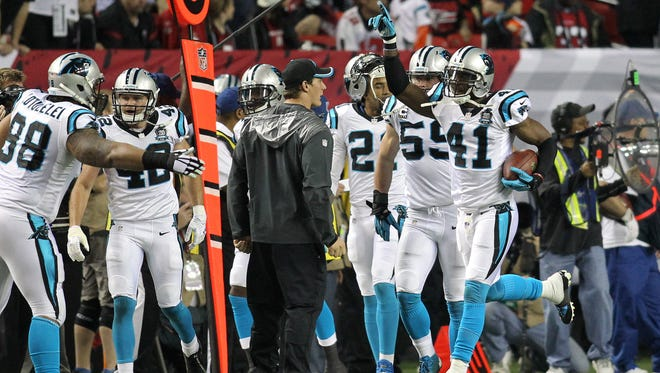 Dec 28, 2014; Atlanta, GA, USA; Carolina Panthers strong safety Roman Harper (41) celebrates a touchdown against the Atlanta Falcons in the second quarter at the Georgia Dome.