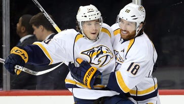 Predators beat Islanders, tie season-long win streak