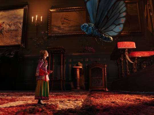 Mia Wasikowska, as Alice, left, and Absolem, voiced