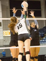 Novi's Paulina Iacobelli (15) goes on the attack against Grand Rapids Christian in Thursday's Class A semifinal.