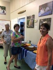 Barbara Greiner, Dottie Graston and Lori Hendricks sample refreshments at the volunteer appreciation party.